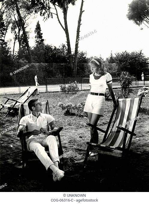 The Italian actors Fabio Testi and Dominique Sandra in a scene from the film The Garden of the Finzi-Contini