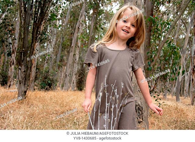 Young girl playing in the woods