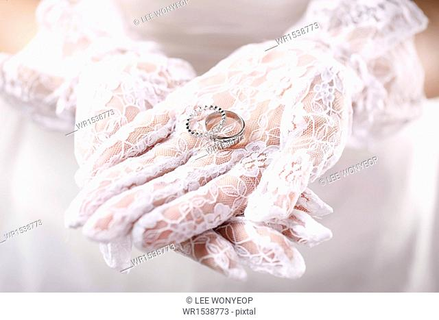 the bride holding a ring in her hands