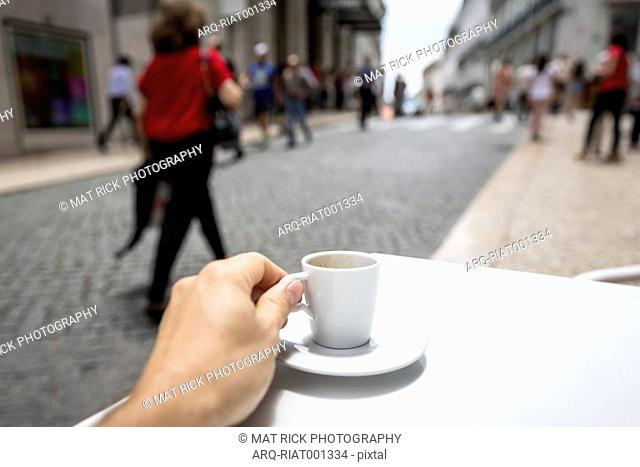 Drinking An Espresso Shot Along A Busy Shopping Street In The Chiado District Of Lisbon\, Portugal