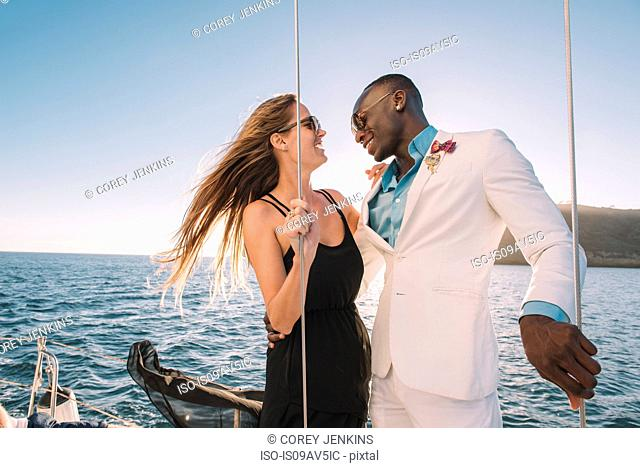 Couple laughing on sailboat, San Diego Bay, California, USA
