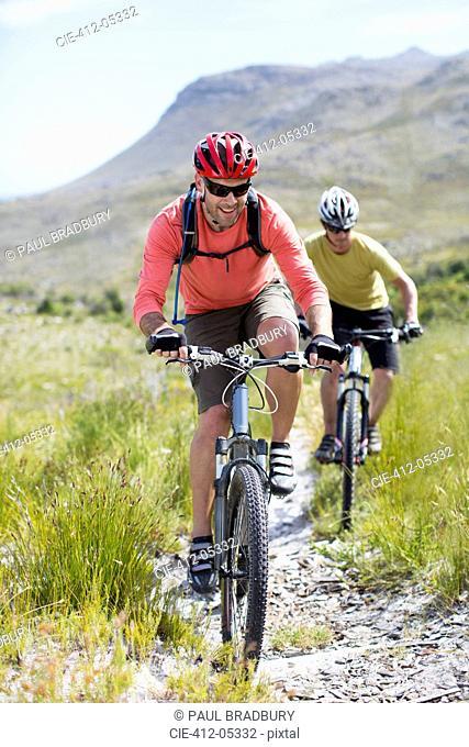 mountain bikers on dirt path