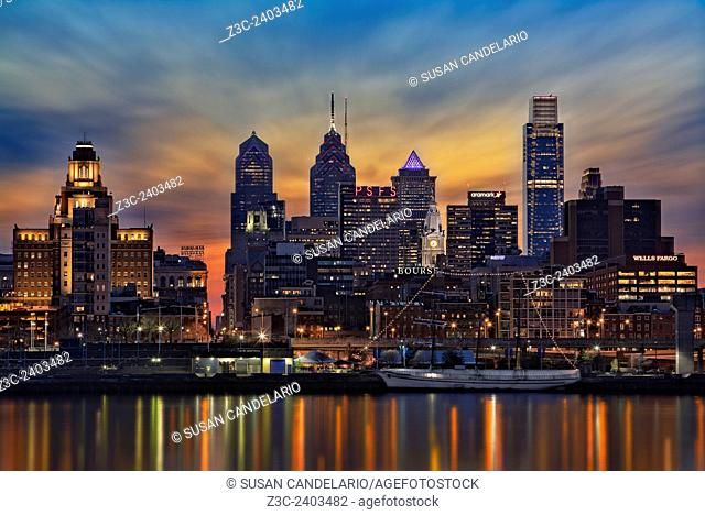 Philadelphia Skyline - A view to the Philadelphia Skyline shortly after sunset. The illuminated urban skyline shows the Comcast Building