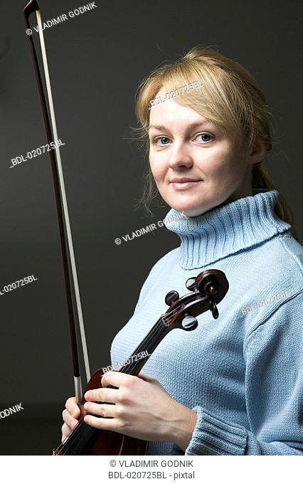 portrait of blond woman with violin