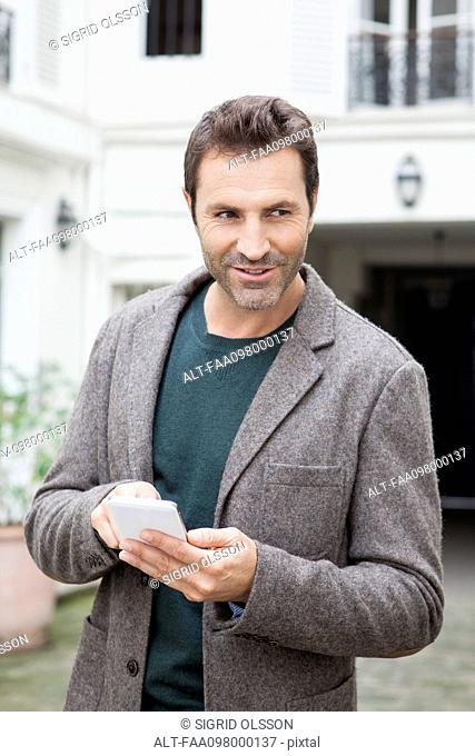 Businessman using smartphone on the move