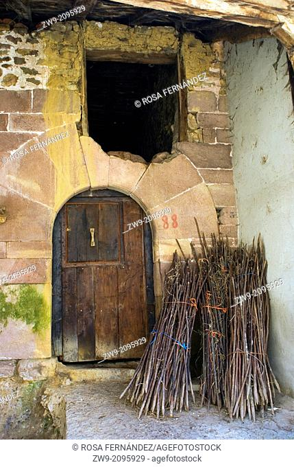 Facade and door of a traditional house of Carmona, Cantabria Region, Spain