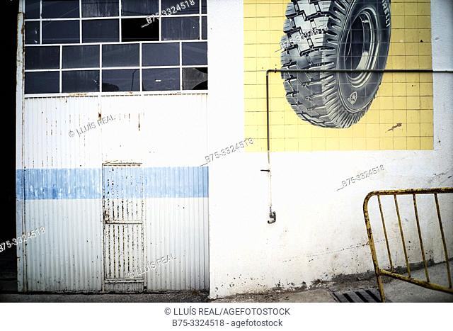 Partial view of the facade of a workshop. Falset, Tarragona, Catalonia, Spain, Europe