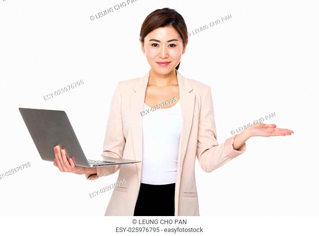 Asian businesswoman use of the laptop computer and open hand palm