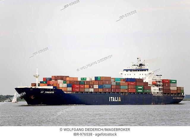 The LT Trieste freighter fully laden with containers at Stadersand/Elbe travelling towards the North Sea, Germany, Europe