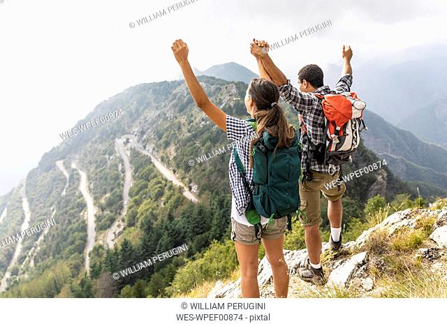 Italy, Massa, happy couple looking at the beautiful view in the Alpi Apuane