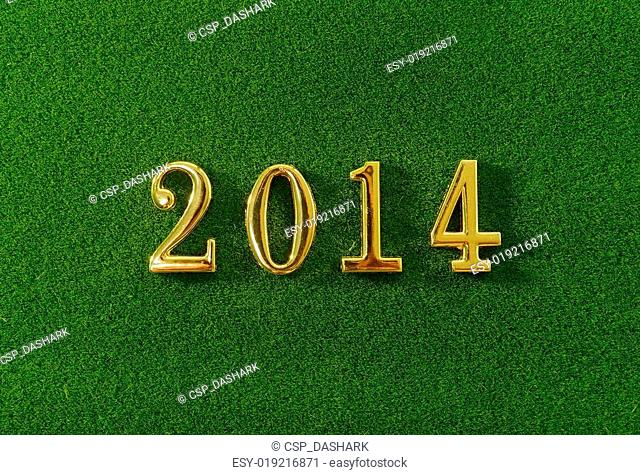 2014 message make of metal numbers on grass background