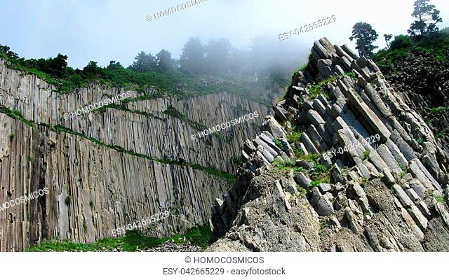 Pillar Rocks of Stolbchatiy cape in Kunashir, Kuril islands, Russia