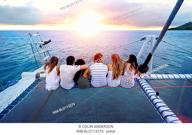 Friends relaxing on boat in ocean
