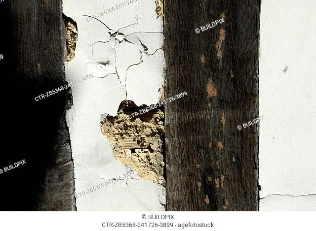 Lime plastering disrepair on an old timber-framed building, Ipswich, United Kingdom