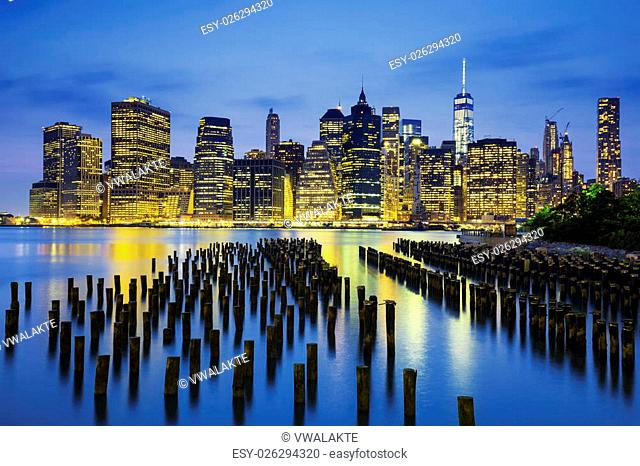 Famous view of New York City Manhattan downtown skyline at dusk, USA