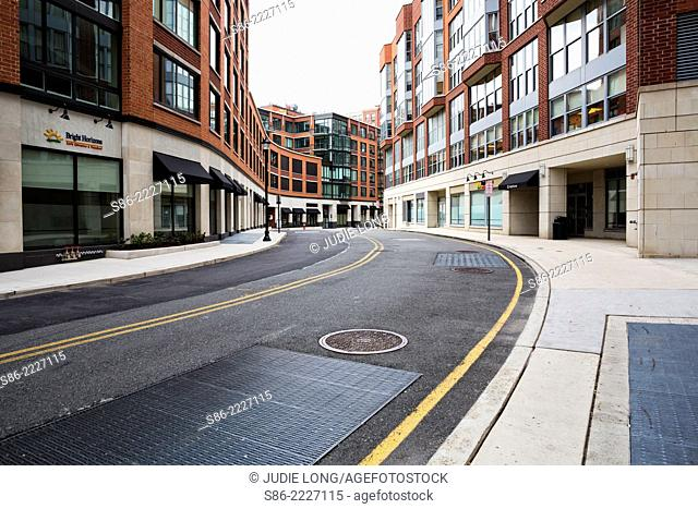 Winding Uphill Street of Modern Shops, Office and Apartment Buildings. Hoboken, NJ, USA