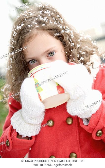 Czech Republic, Portrait girl (4-5) having hot drink in Wintertime