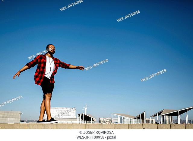 Man listening to music and dancing with headphones outside