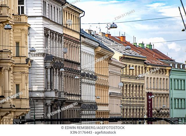 Side view of colorful buildings and windows with skyline in background in Prague - Czech Republic