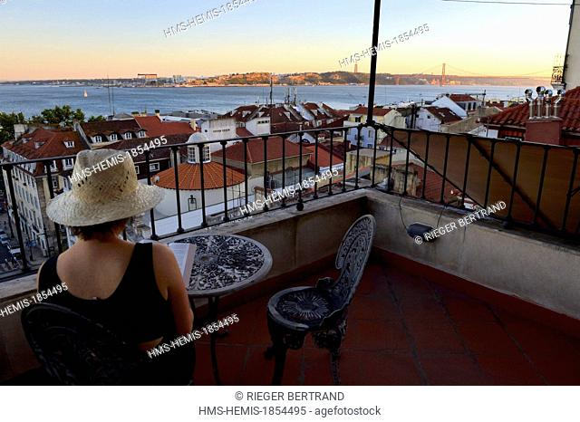 Portugal, Lisbon, Chiado district, terrace with view on the south bank of the Tagus river and the 25 de Abril bridge