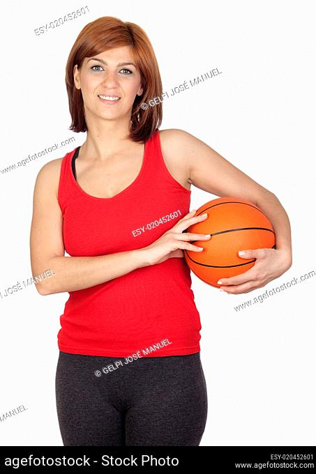 Beautiful redhead girl with a basketball