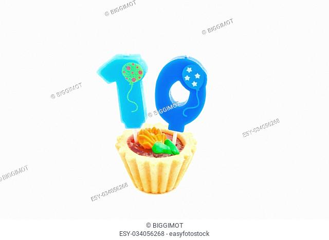 cake with ten years birthday candle on white background