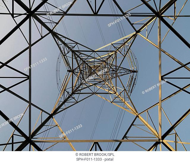 View of electricity pylon and power lines looking vertically upwards from ground level. Photographed in Wednesbury, West Midlands, UK