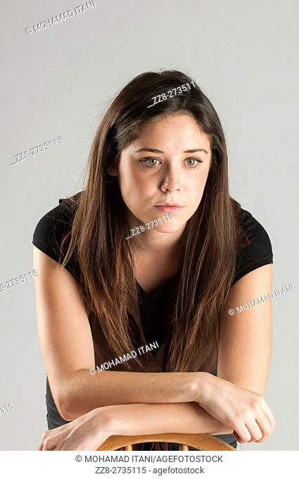 Serious young woman looking away thinking