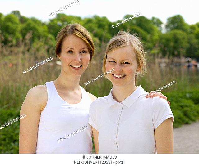 Two young women smiling, portrait