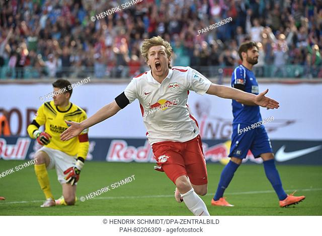 Leipzig's Emil Forsberg (C) celebrates the 1-0 goal, with Karlruhe's goalkeeper Rene Vollath pictured to his left, during the German second division Bundesliga...