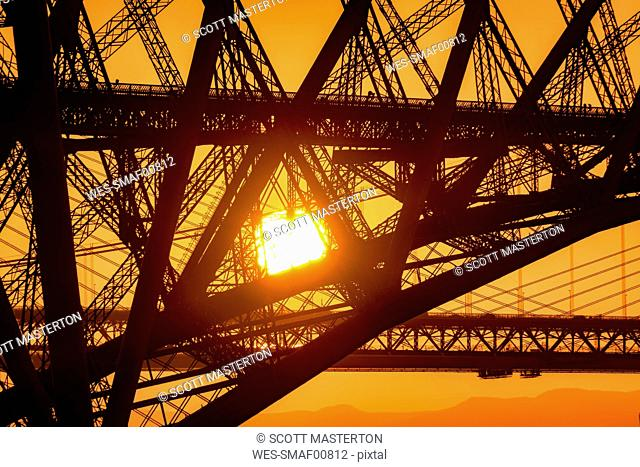 UK, Scotland, Fife, Edinburgh, close-up of Firth of Forth estuary, Forth Bridge, Forth Road Bridge and Queensferry Crossing Bridge in the background at sunset