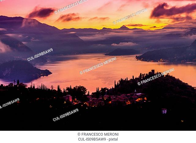 Cloud covered mountains across Lake Como at sunset, Varenna, Italy