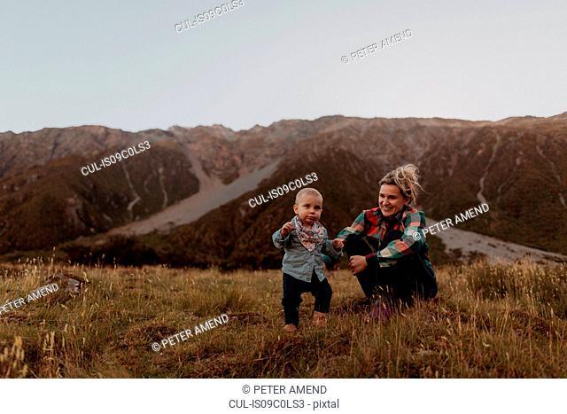 Mother and baby exploring wilderness, Wanaka, Taranaki, New Zealand