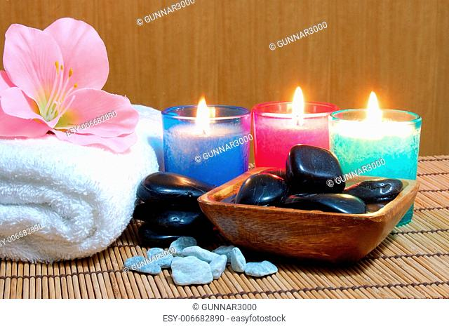 spa and wellness concept with flowers zen stones and towel