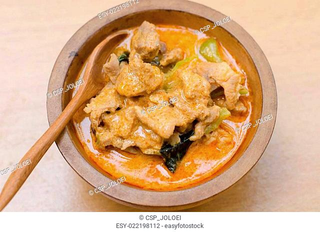 Red savory curry paste with pork and coconut milk (Panang)