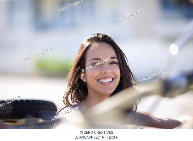 Young woman in a convertible