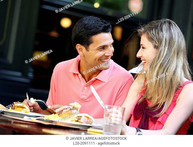 Couple eating in a restaurant. San Sebastian. Donostia. Gipuzkoa. Basque Country. Spain