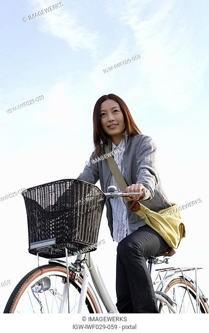 View of a young woman on a bicycle