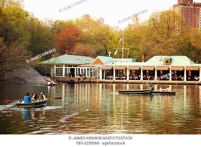 People enjoy a warm spring day rowing on the lake in New Yorkâ. . s Central Park