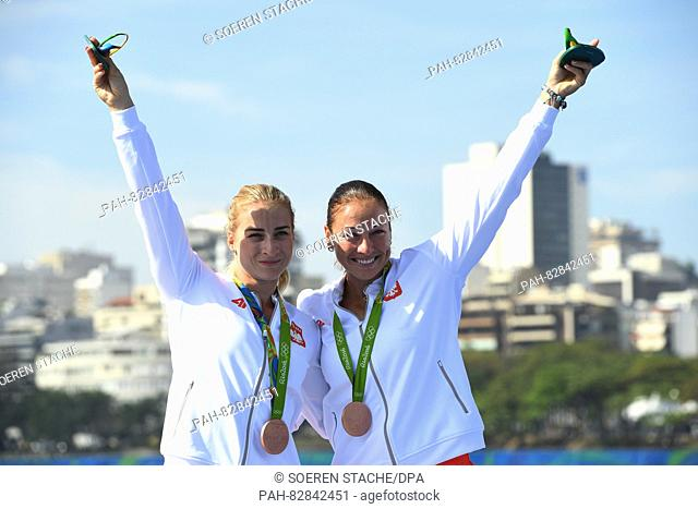 Bronze medalists Karolina Naja (L) and Beata Mikolajczyk of Poland display their medals during the medal ceremony after the Women's Kayak Double 500m Final...
