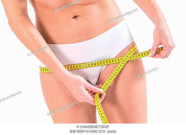 Woman measuring hip