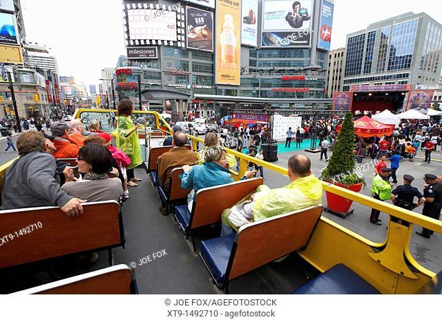 open top guided bus city tour top deck downtown yonge dundas square toronto ontario canada