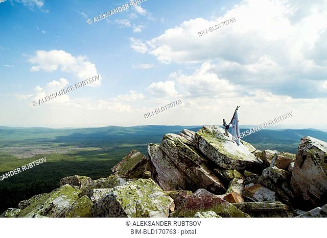 Banner on rocky hilltop in remote landscape
