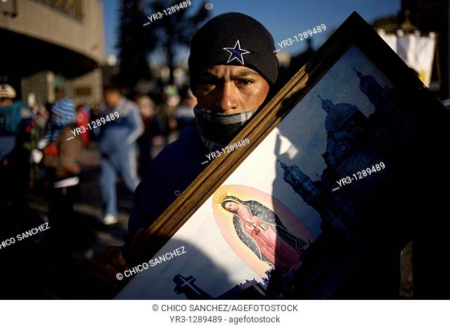 A pilgrim carries an image of the Our Lady of Guadalupe in Mexico City, December 10, 2010  Hundreds of thousands of Mexican pilgrims converged on the Our Lady...