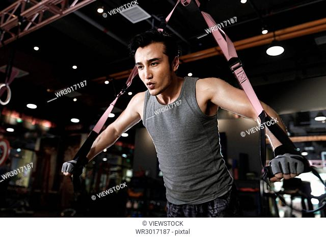 Young men exercise in the gym