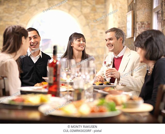 People eating together in restaurant