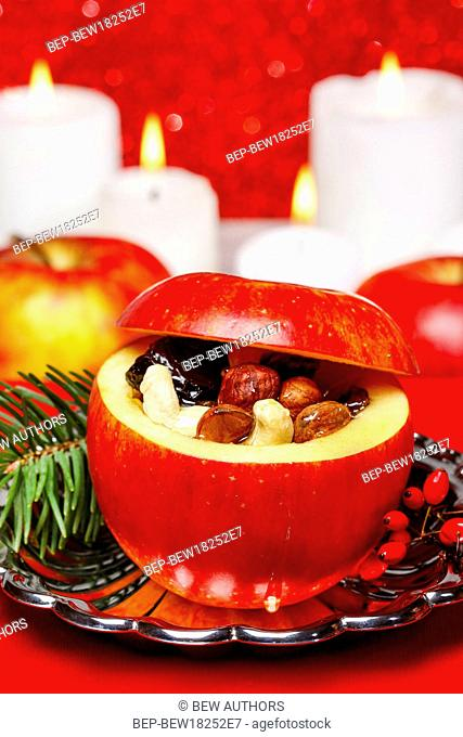 Red christmas apples stuffed with dried fruits in honey