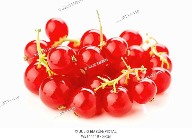 heap of ripe red currants on white