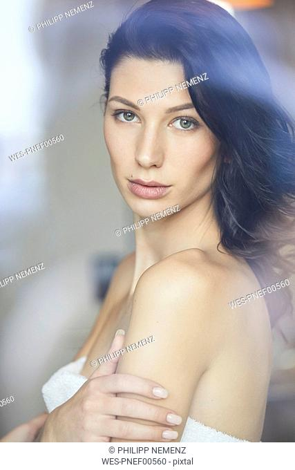 Portrait of attractive dark-haired young woman