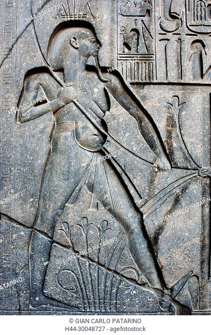 Luxor, Egypt. Temple of Luxor (Ipet resyt): sculpture in the base of the giant statue of king Ramses II representing the union of two lands (Sema-tawi)